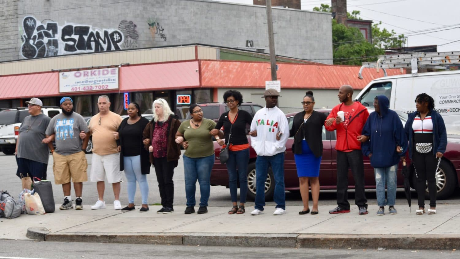 Photo for As gun violence continues, Providence residents lock arms for peace
