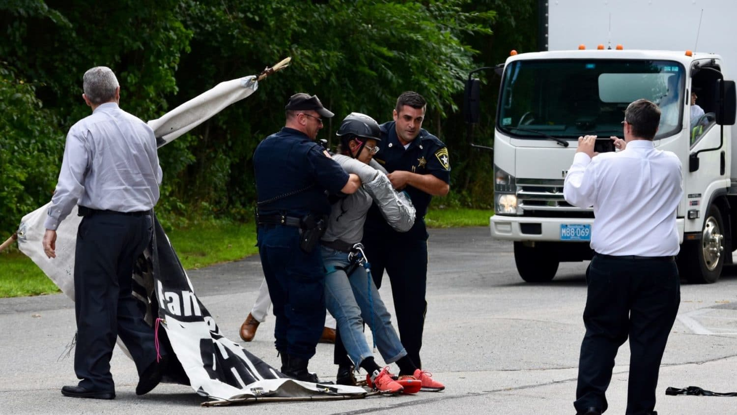 Photo for Video: Officers topple FANG tripods blocking entrance to Bristol County Jail