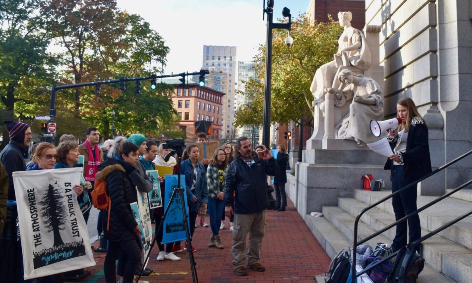 Photo for Rhode Island Rally for the #TrialoftheCentury calls on the government to respond meaningfully to the danger of climate change