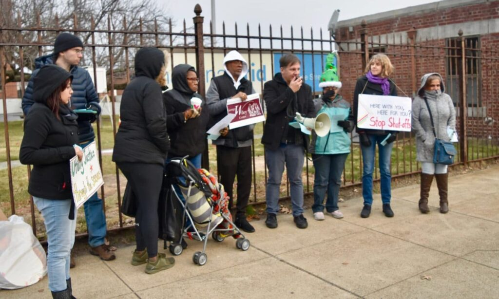 George Wiley Center demands a walk-in payment center from National Grid, with Christmas Carols