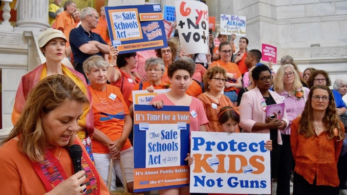 Photo for Faith leaders rally at the State House to demand safer schools