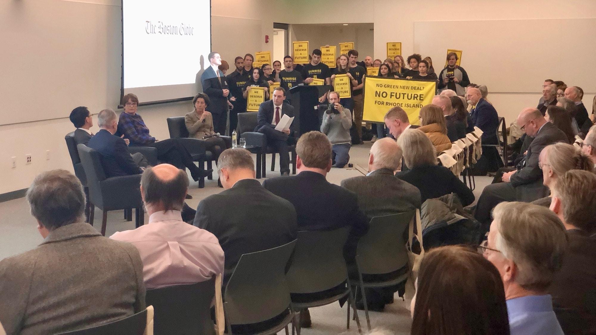 Photo for Sunrise disrupts Governor Raimondo's appearance at Boston Globe forum on Rhode Island's future