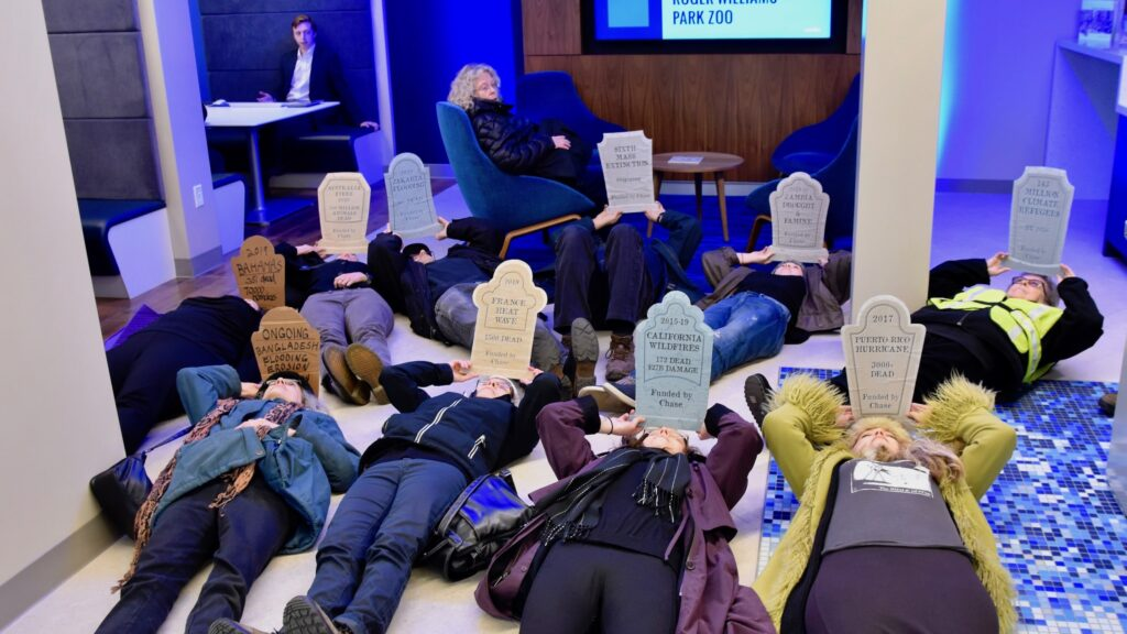 Protesters stage a die-in at Chase Bank, the leading funder of climate change
