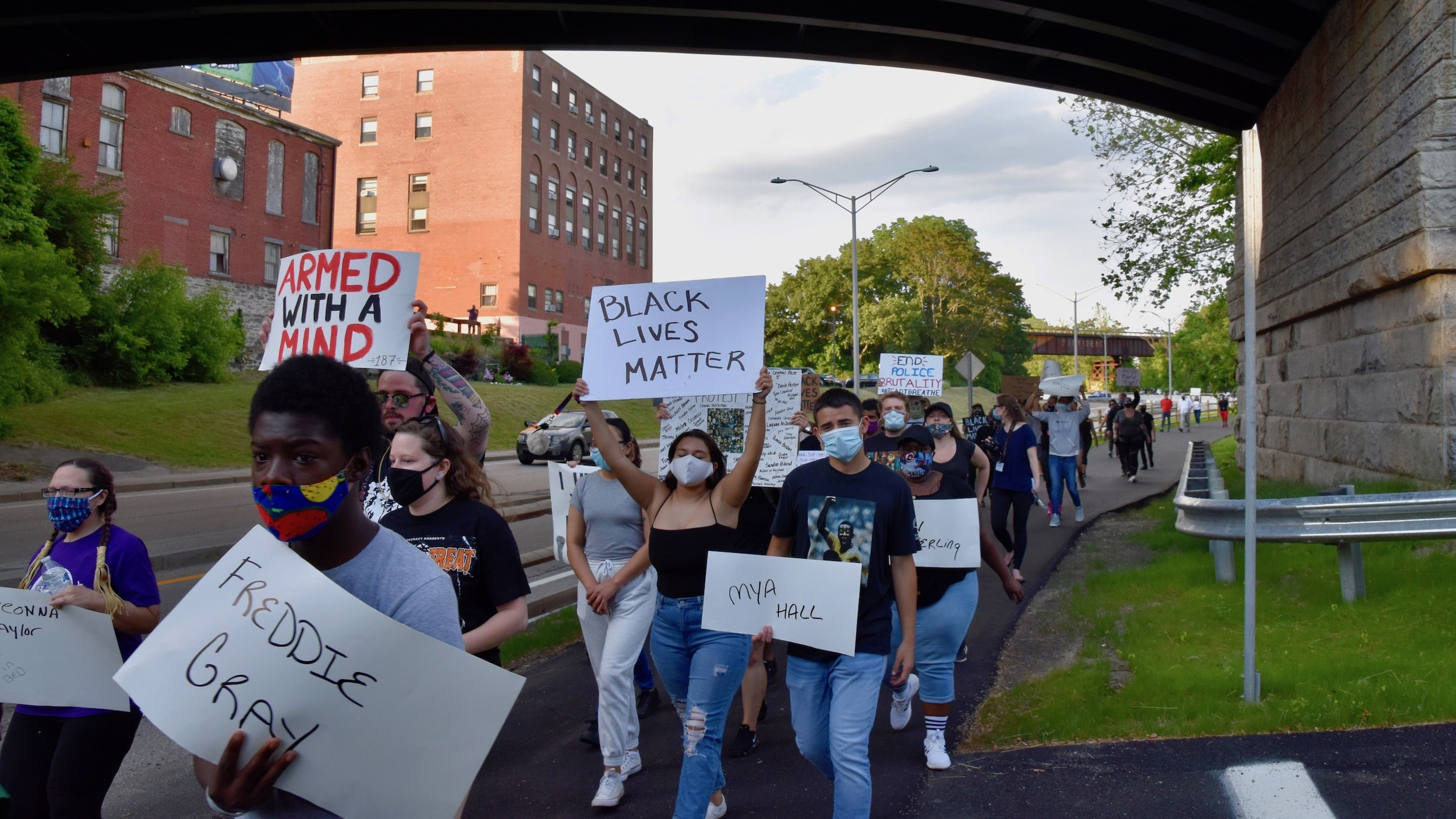 Photo for Over a hundred march against police brutality in Woonsocket