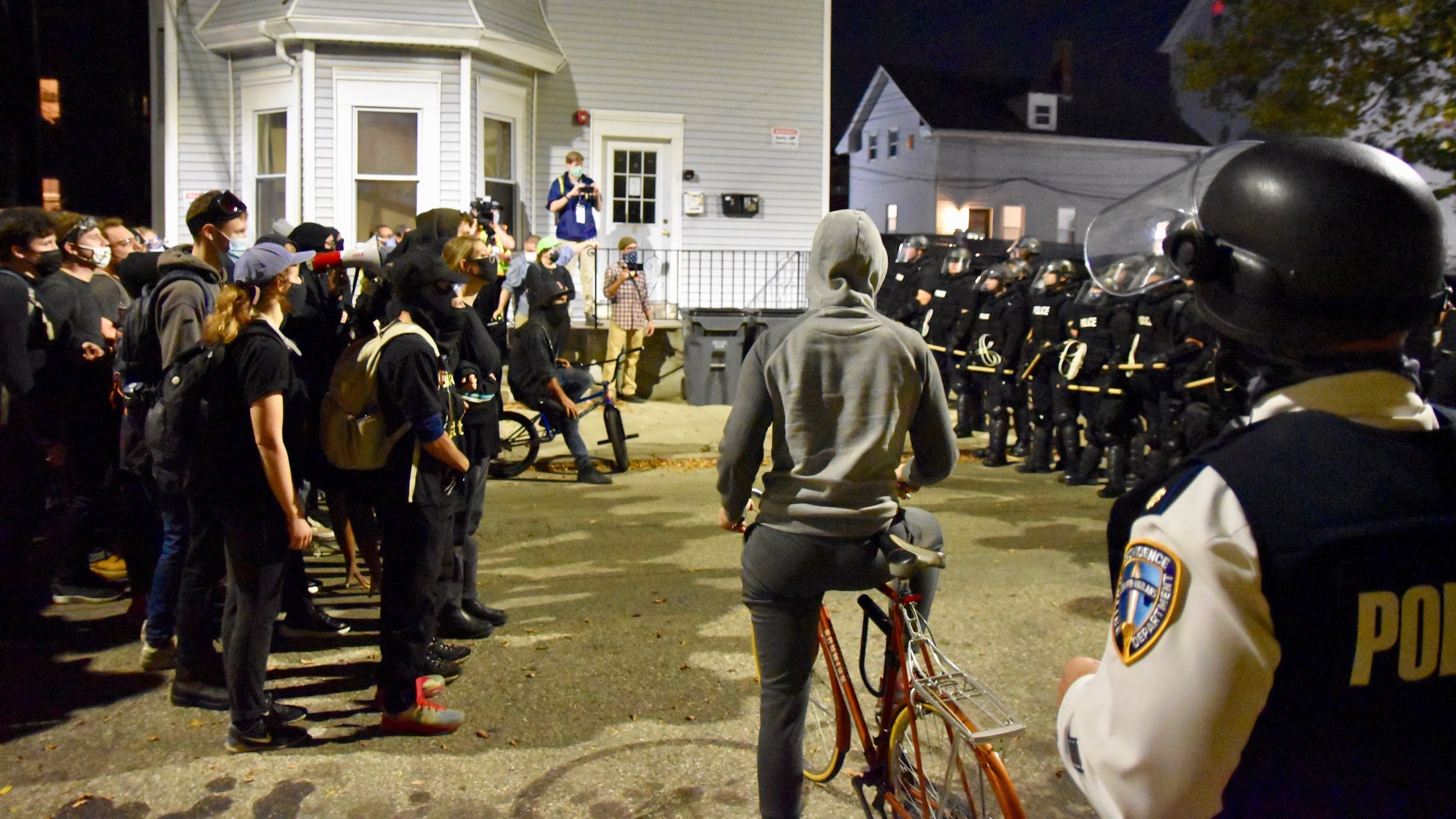 Photo for Police in riot gear prevent Federal Hill restaurant patrons from viewing peaceful protesters