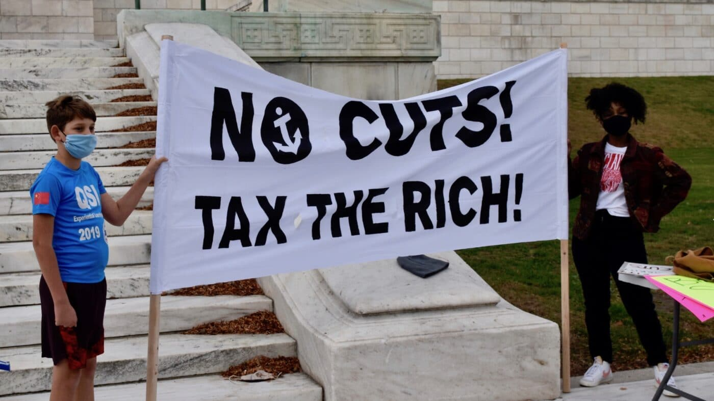 Coalition rallies for taxes on rich to fund essential services