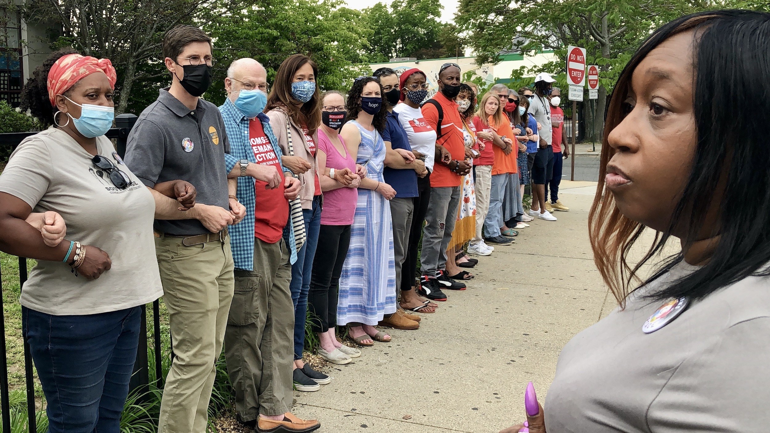 Photo for Locking Arms for Peace returns in response to recent gun violence