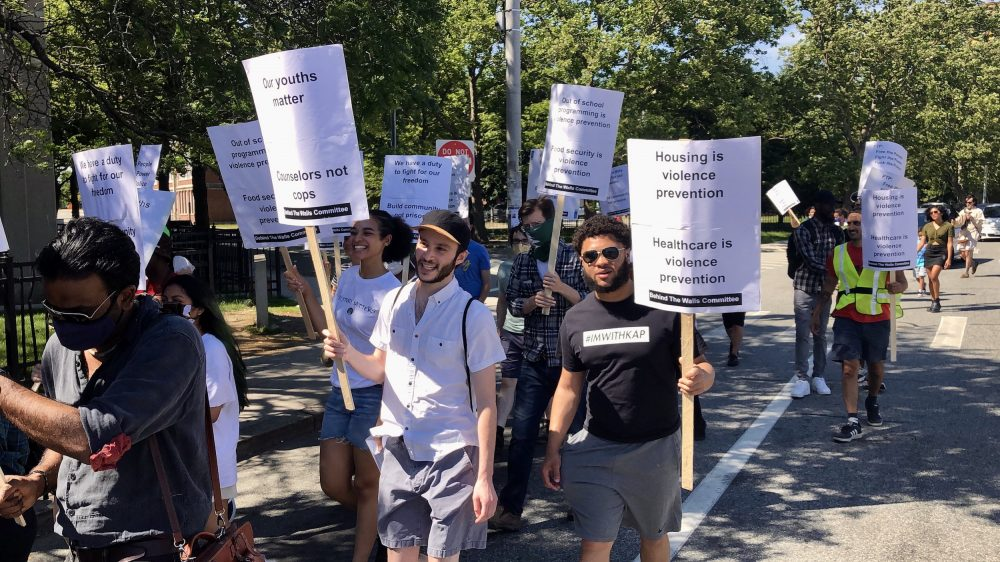 Coalition marches on Nonviolence Institute to demand an end to close cooperation with police