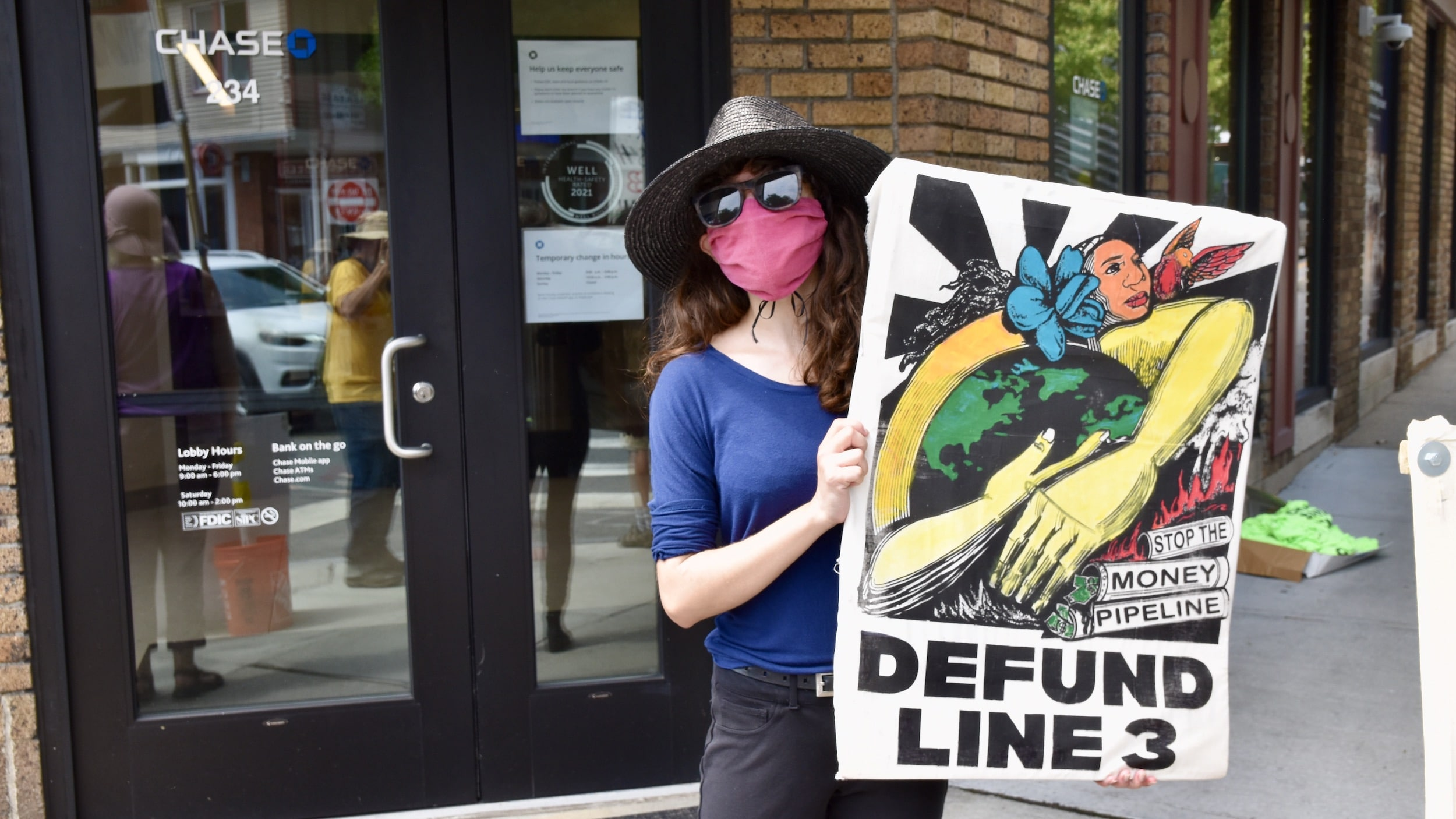 Photo for Climate Action RI holds Art / Music Protest outside fossil fuel funder Chase Bank in PVD