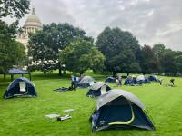 Homelessness advocates erect tents on the State House lawn to be noticed