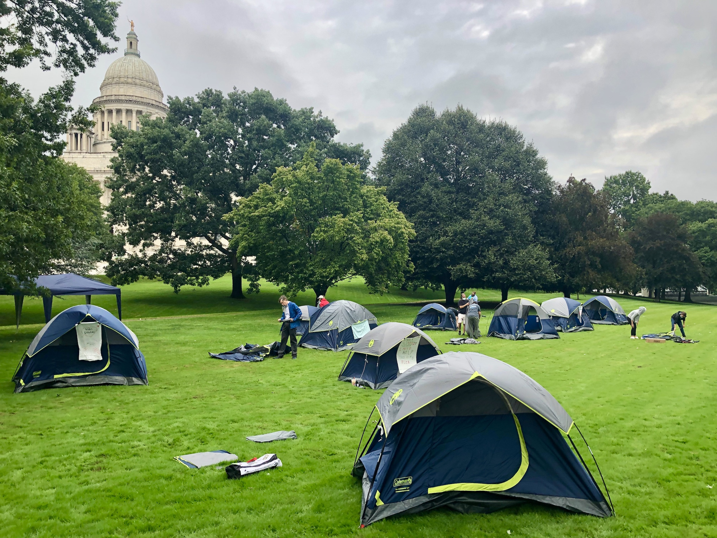 Photo for Homelessness advocates erect tents on the State House lawn to be noticed