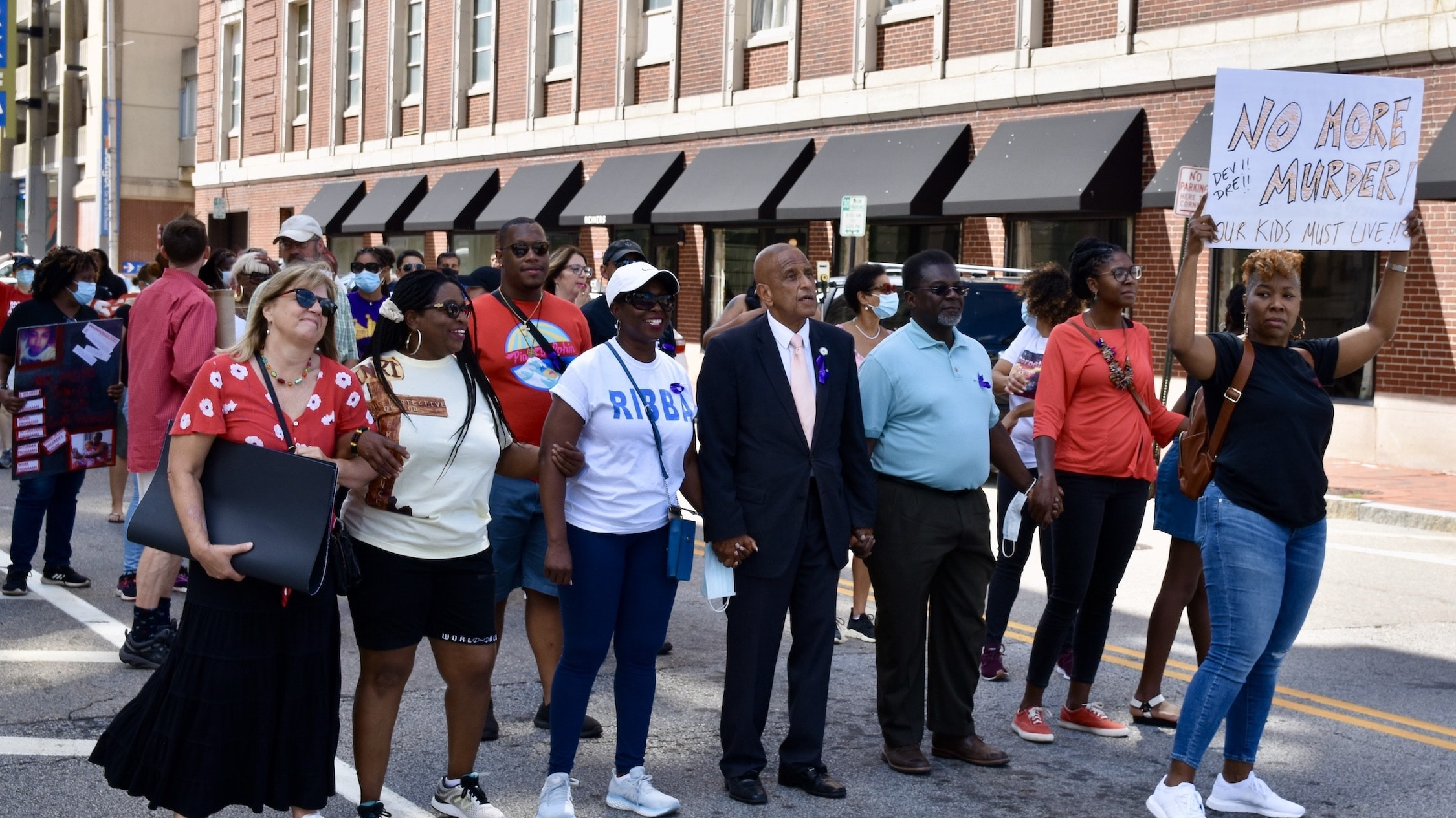 Photo for Survivors, advocates and politicians walk against gun violence in Providence on Saturday