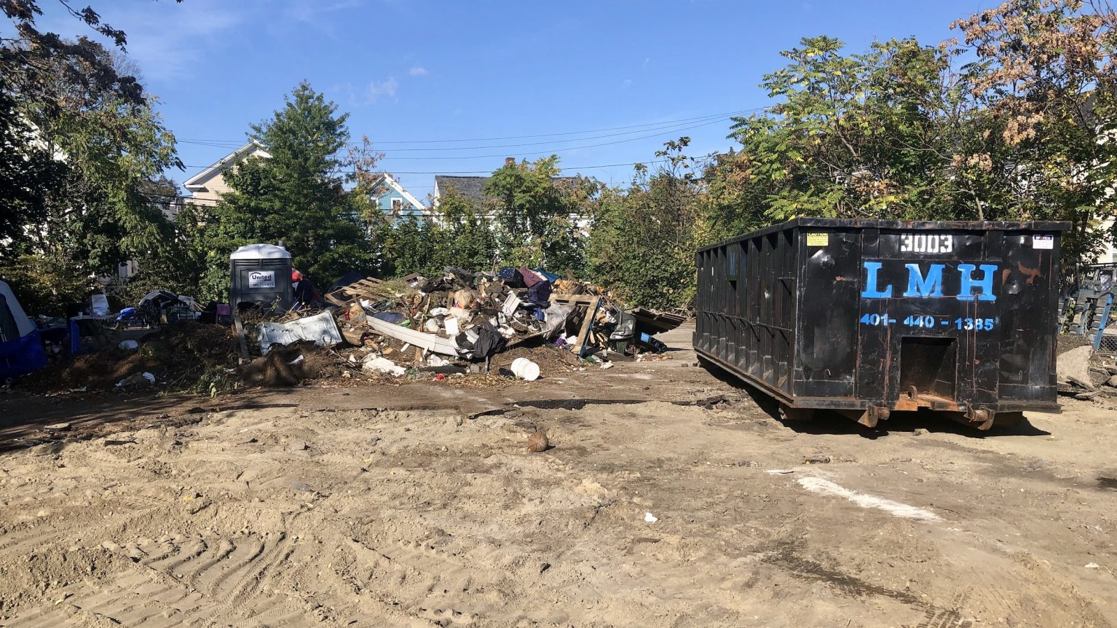 City officials surprised as unhoused encampment on Wilson St is half bulldozed by developer Knight & Swan